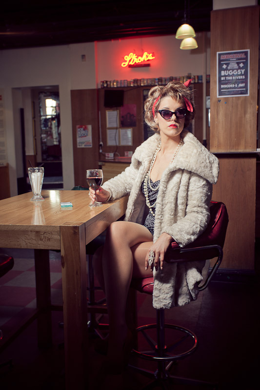 Jess enjoys a glass of wine in this bar room scene at The Lanes